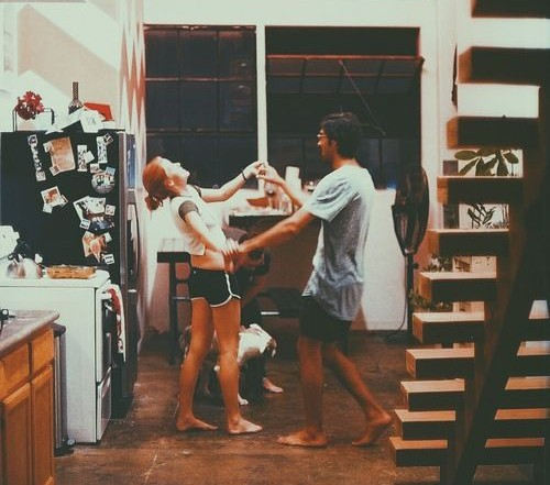 couple dancing in kitchen