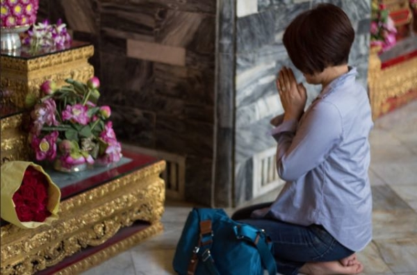 Buddhist Woman praying